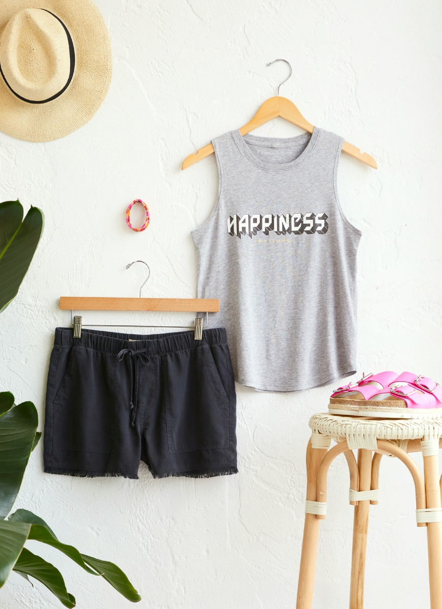 Lay down of tanks and shorts with pink sandals