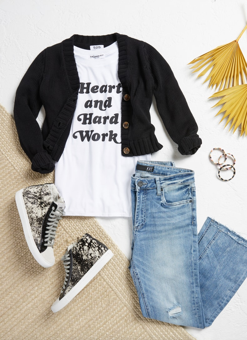 Lay down of cardigan, graphic tee, and hi tops