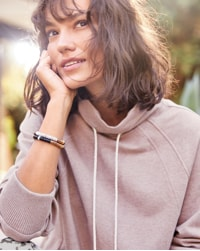 woman in mauve sweatshirt