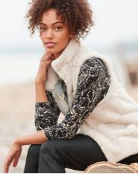 woman in cozy cream fur zip vest