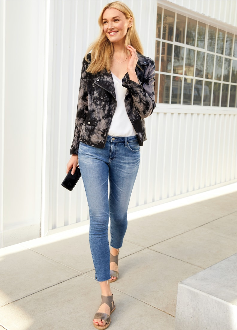 Woman wearing tie dye jacket with jeans and sandals