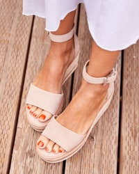 woman in neutral sandals – shop shoes