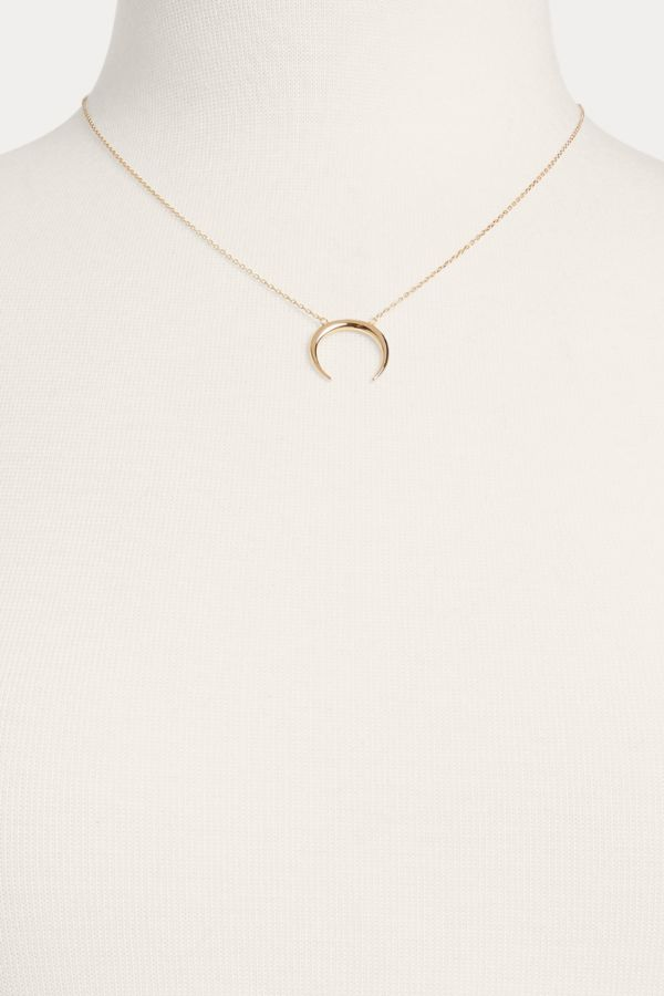 Thirty-nine 42 Crescent Pendant Necklace