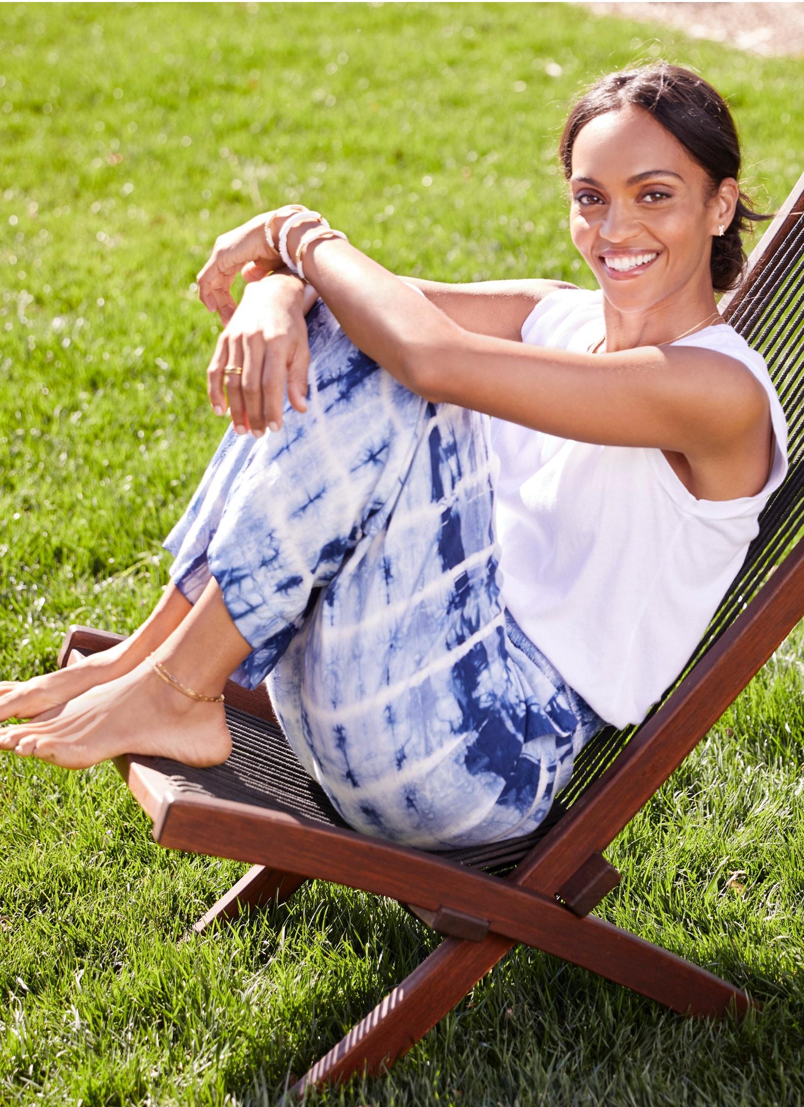 Woman wearing white tank and blue tie dye pants