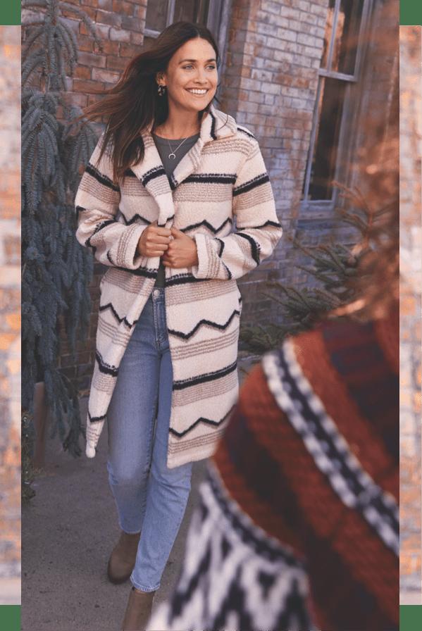 woman on the street wearing cozy sweater-coat