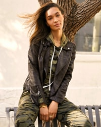 woman in matching camo sweatshirt and joggers