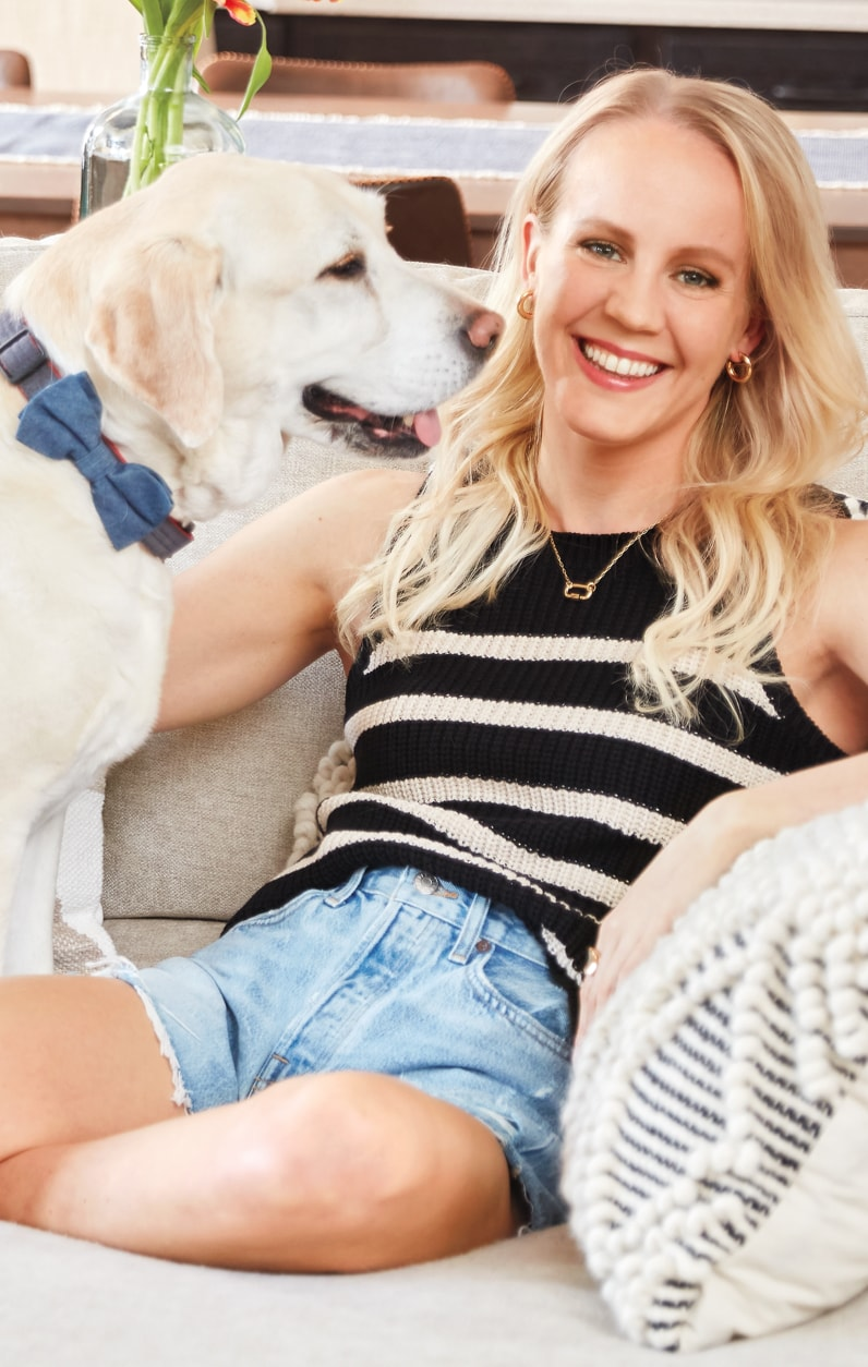 Mallory wearing cutoff jean shorts and a striped tank