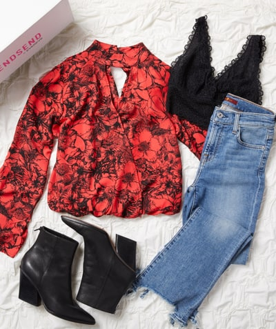 trendsend box laydown: floral black and red blouse, black bralette, jeans and black boots