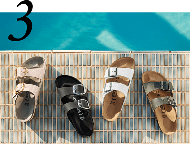 row of different styles of Birkenstocks by the side of the pool