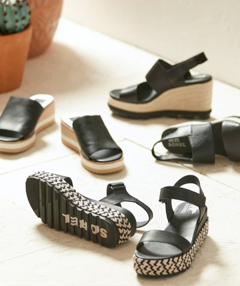 Studio laydown of an assortment of fashion sandals – Shop Sandals