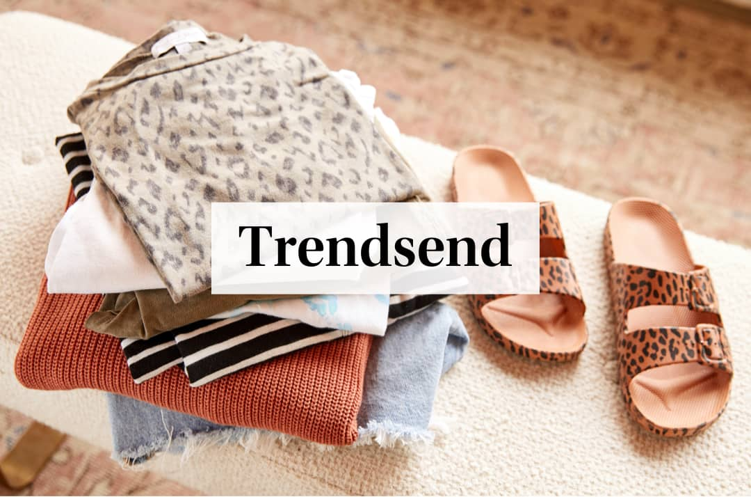 Woman opening up her Trendsend Box at home - Order Your First Trendsend.