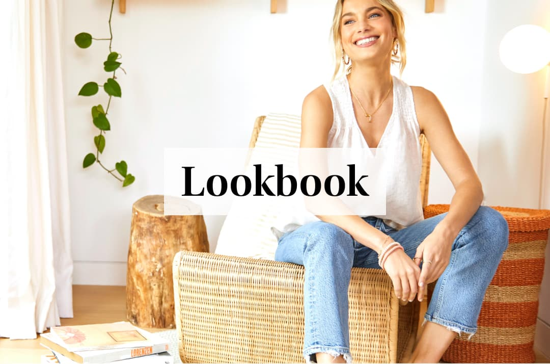 woman in her home wearing white v-neck tank and jeans – Shop Lookbook
