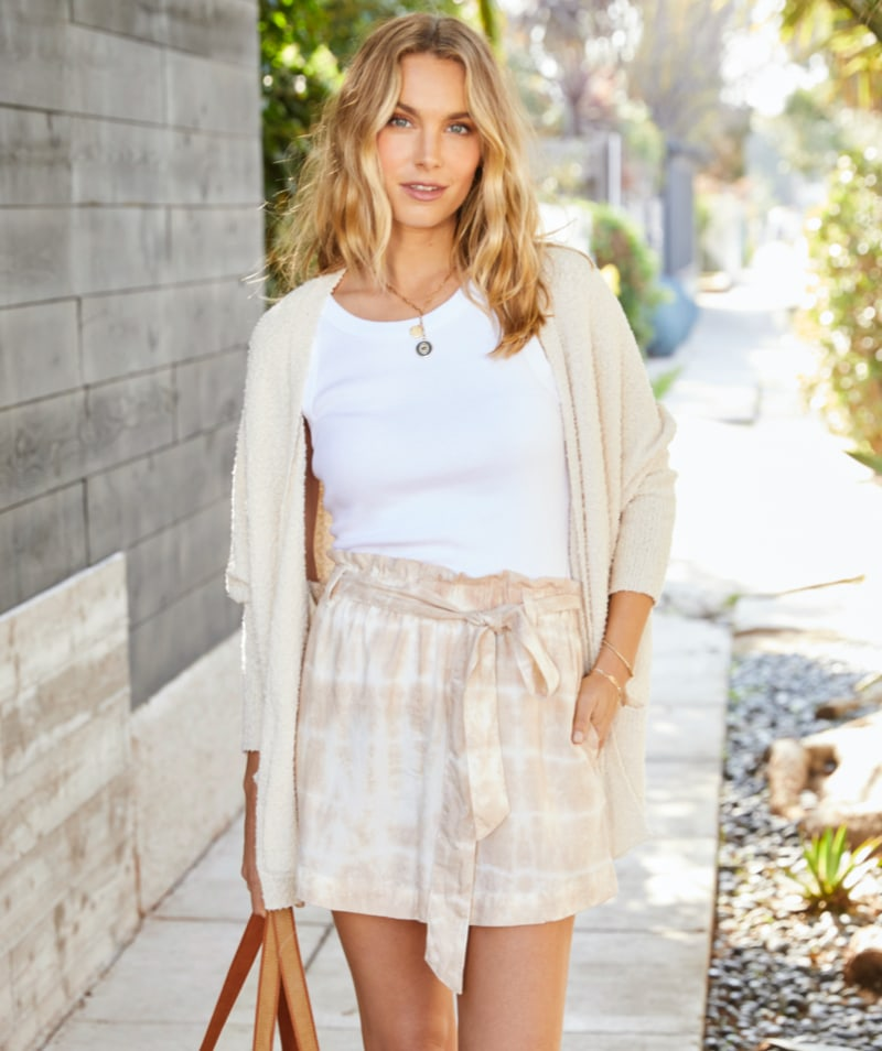 woman in Parker cutoffs and cream sweater - Shop Shorts