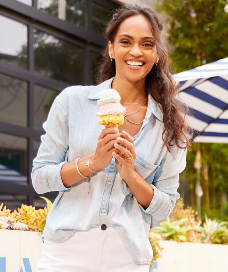 woman is light blue button-down and white shorts – Shop Tops