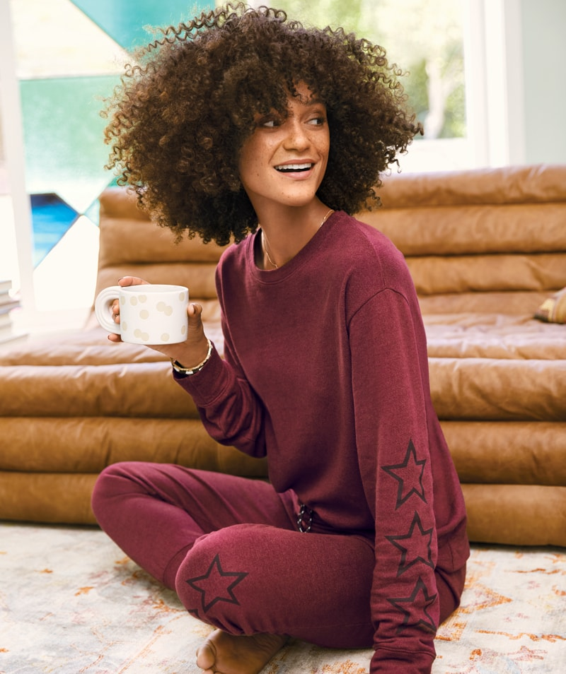 woman in a maroon colored matching set with black star graphic details – shop matching sets.