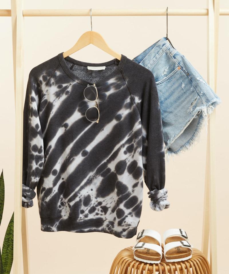 black and white tie-dye sweatshirt, light wash cutoffs and white Birkenstocks - shop new arrivals