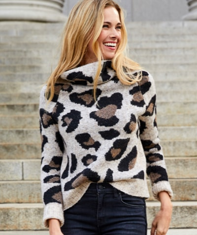woman in cozy animal print turtleneck – shop sweaters