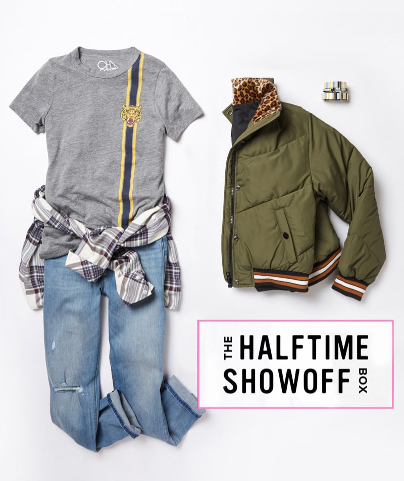 Studio laydown of a Trendsend theme box that includes a grey graphic tee, plaid button-down, jeans and a green puffer jacket - Order A Theme Box