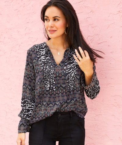 woman in black, grey and white pattern blouse with black joggers
