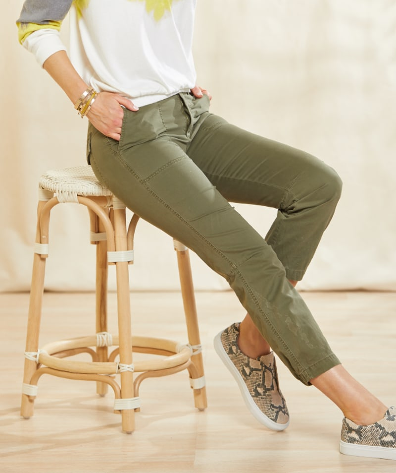 woman in olive green utility pants and a tie-dye sweatshirt with sneakers – Shop Utility Pants