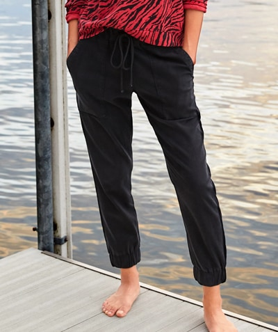 woman wearing casual, comfortable black jogger pants