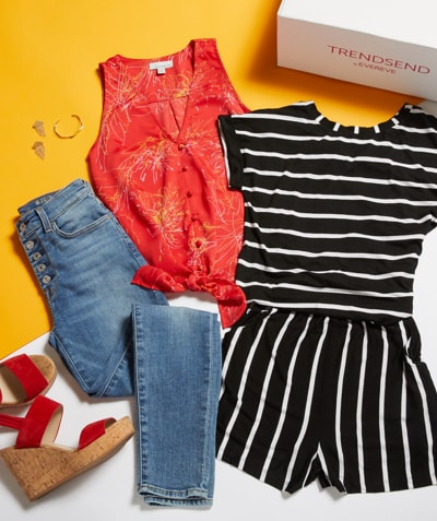 laydown of black and white stripe jumper, red button-down tank, high rise jeans, earrings, wedge sandals and a trendsend box